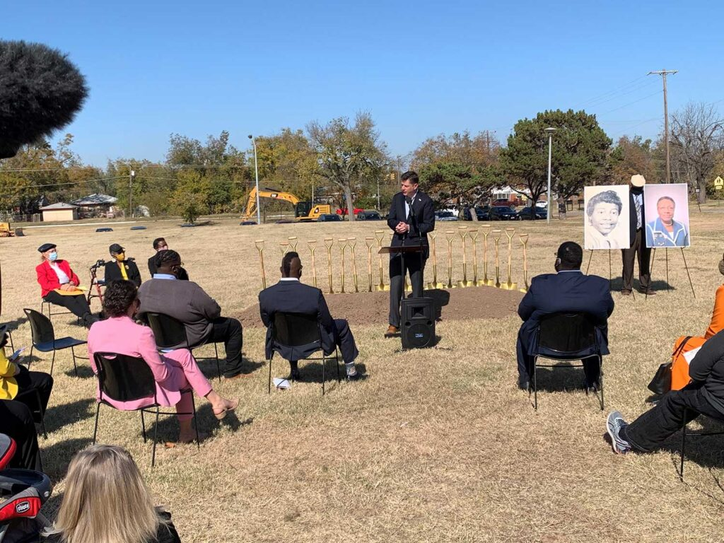 A crowd of people, including Mayor David Holt, at a groundbreaking ceremony.
